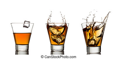 whisky splash in glass isolated on a white