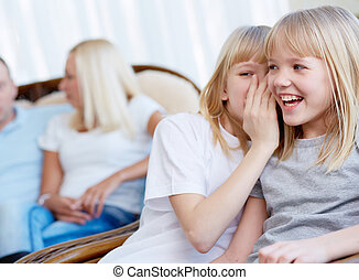 Whisper - Portrait of happy girl laughing while her twin...