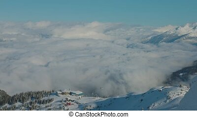 Whistler, British Columbia, Canada. Beautiful Panoramic View of Peak to Peak Gondola with the Canadian Snow Covered Mountain Landscape during a cloudy and vibrant winter morning.