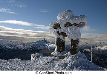 "Whistler peak with the ""Ilanaaq the Inukshuk"" statue"