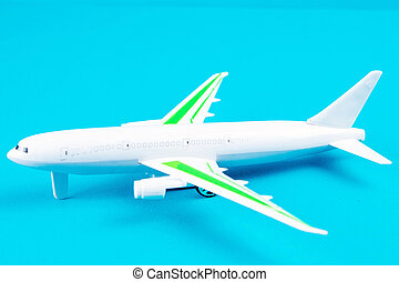 white airplane on a blue background, top view