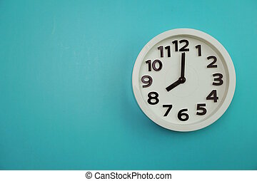 White alarm clock top view on Blue background