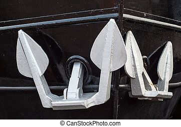 White anchors of a black ship