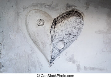 white and black stone heart