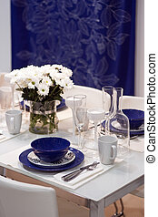 White and blue dining table in restaurant