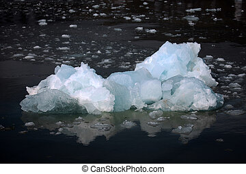 White and blue ice, small icebergs floating in Svalbard, Norway