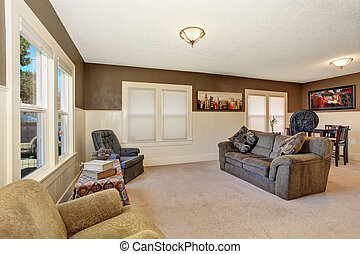 White and brown living room interior with comfortable sofa and beige carpet.