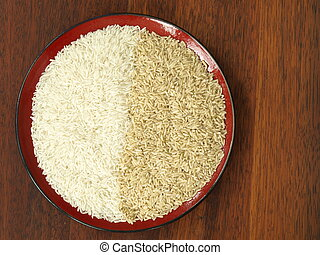 White and brown rice - Bird eye view of rice: brown and...