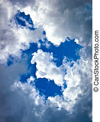 White and dark clouds on blue sky
