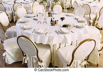 White and gold colored chairs