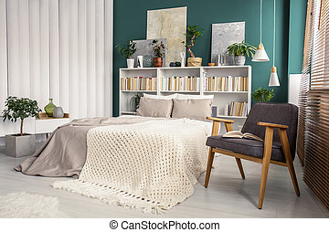White and green bedroom interior