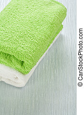 white and green towels
