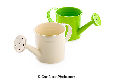 White and green watering cans - Gardening: white and green...