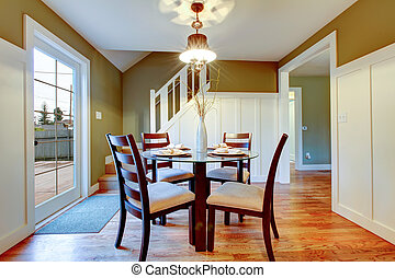 White and olive dining area with classic dining table set