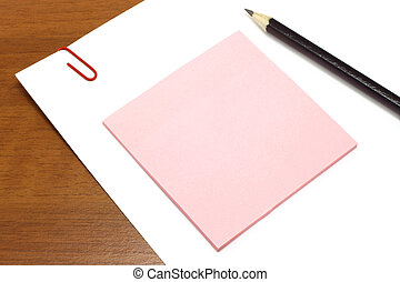 White and pink paper with pencil