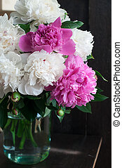 white and pink peonies on wooden background