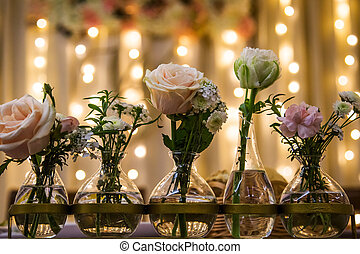 White and pink roses in vases, vintage home decor on the table,
