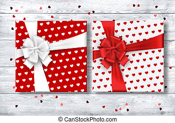 White and red, gift box with bow on a white background. Romance, Valentine's Day, love.