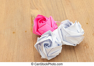 white and red paper rose on wood background