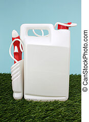White And Red Spray Container In The Grass