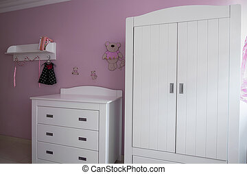 White and rose baby room
