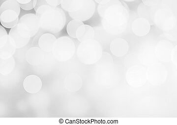 White and silver abstract bokeh lights. Sparkling Christmas defocused background