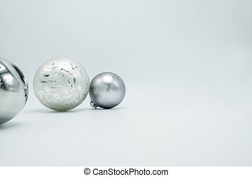 White and silver christmas balls isolated on white background.