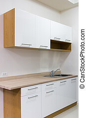 White and wood kitchen cabinet set in room