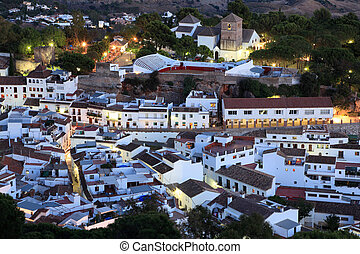 White Andalusian village Mijas Pueblo at dusk. Costa del...
