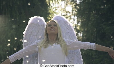 White Angel - Blonde girl in a white dress with angel wings...