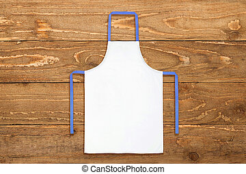 White apron against old wooden background