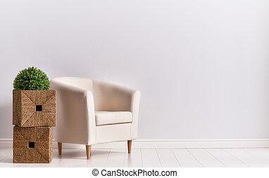 armchair on empty wall