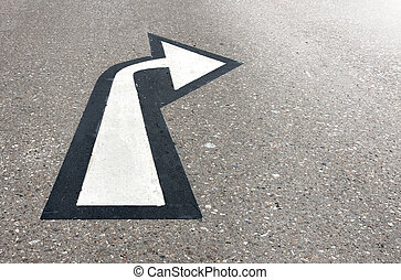 White arrow on asphalt