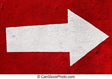 White arrow on the red concrete.