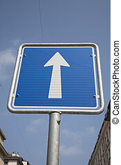 White Arrow One Way Sign on Blue Sky Background