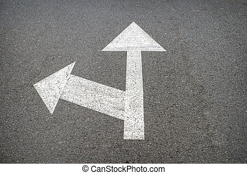 white arrows on asphalt road - street arrow