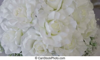 White artificial flowers on the wedding table