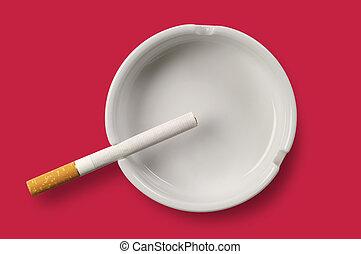 White ashtray and cigarette
