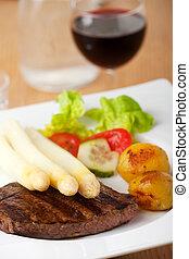white asparagus on an steak