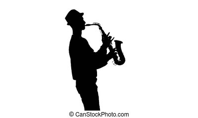 White background in studio. Silhouette jazzman performs solo on saxophone