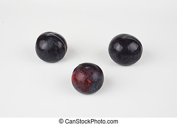 White background with black plums.