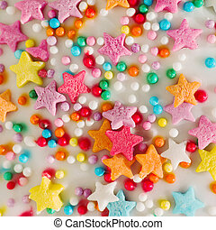 White background with multicolored sprinkles confectionery