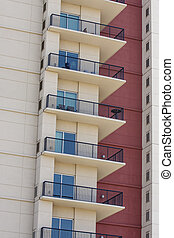 White Balconies on Red Wall