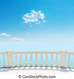 white balcony near sea and blue sky with cloud over it