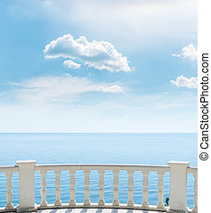 white balcony over sea and clouds in blue sky