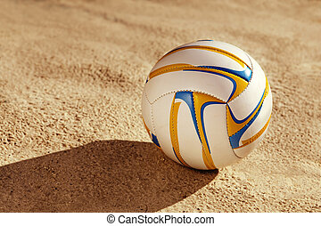 white ball on sand