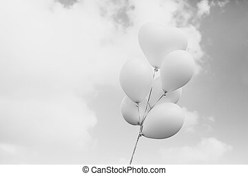 white balloons on blue sky background