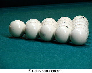 White balls on green textile pool table