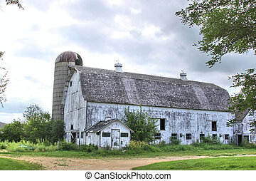 White barn and silo - An old white barn with the paint...