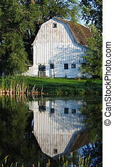 white barn on a farm in the country